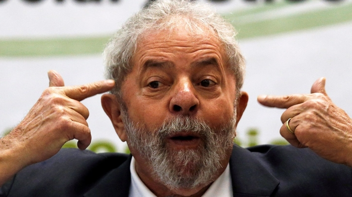 "Former Brazilian President Lula da Silva gestures as he attends a ""Democracy and social justice"" seminar in Sao Paulo"